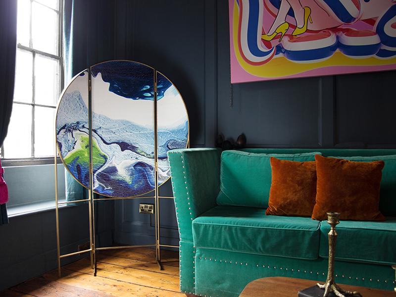 A master craftsmanship marbled room screen alongside a sofa