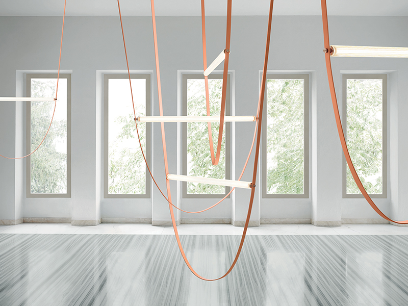 LED lights hung from the ceiling on crafted straps