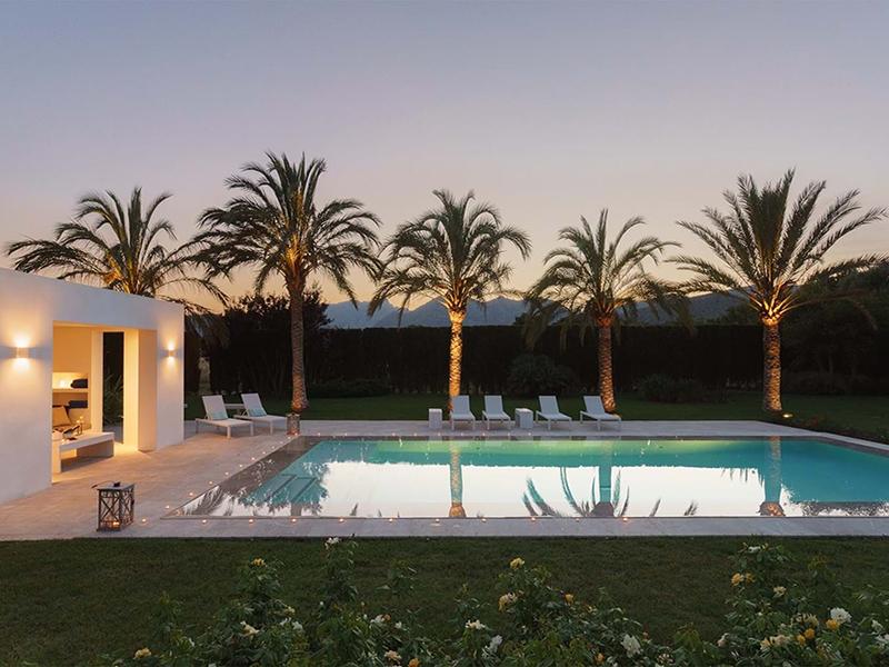 Palm trees and pool outside villa