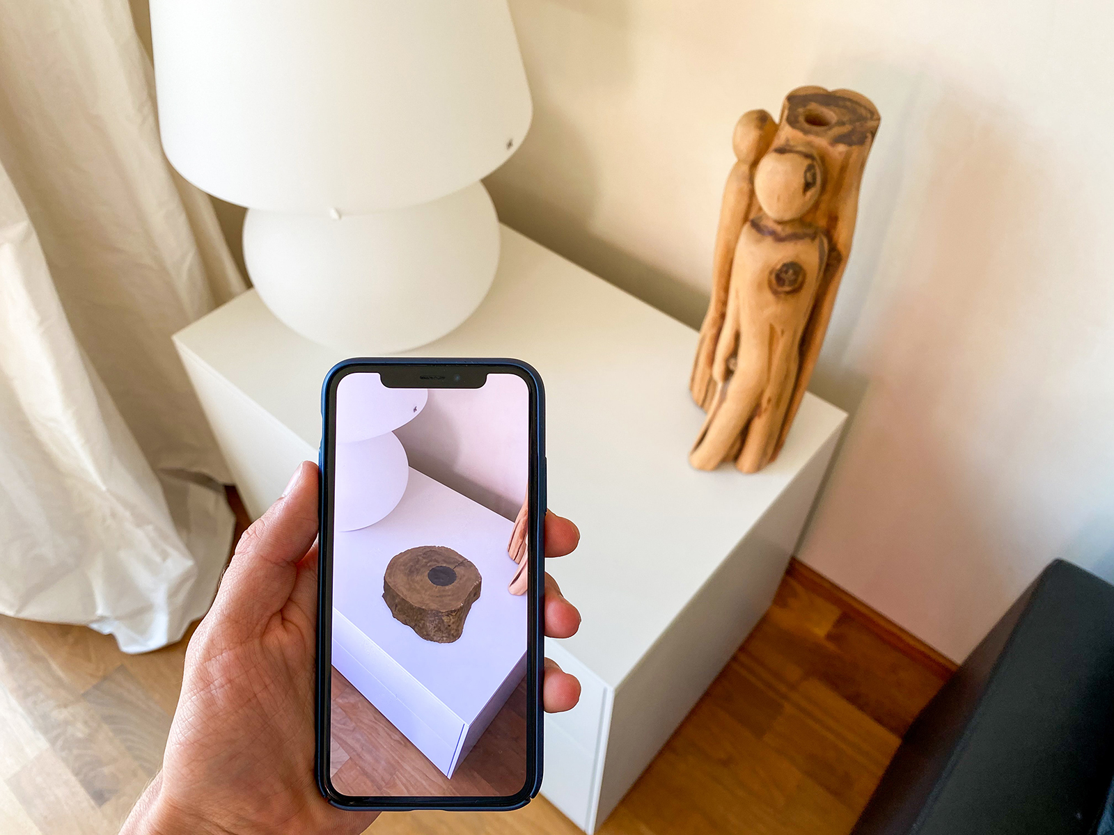 An iPhone displays what a atrifact would look like in someone's home