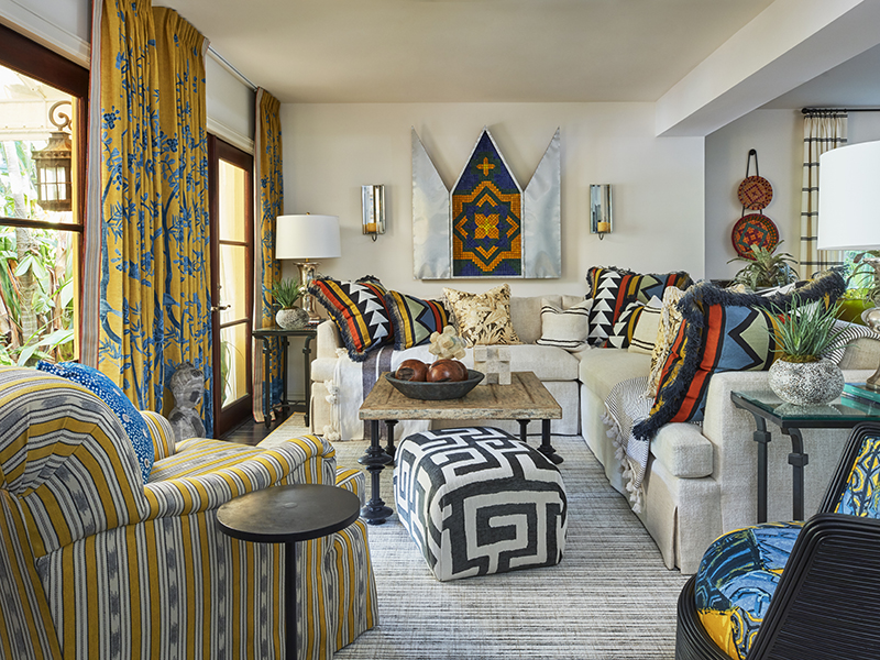 A living room filled with colorful and eclectic patterns