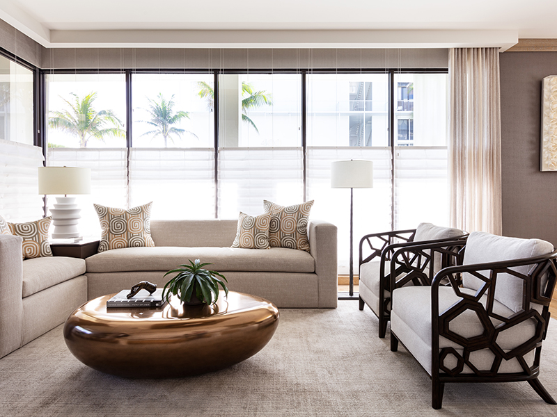 A neutral living space with bold brass coffee table