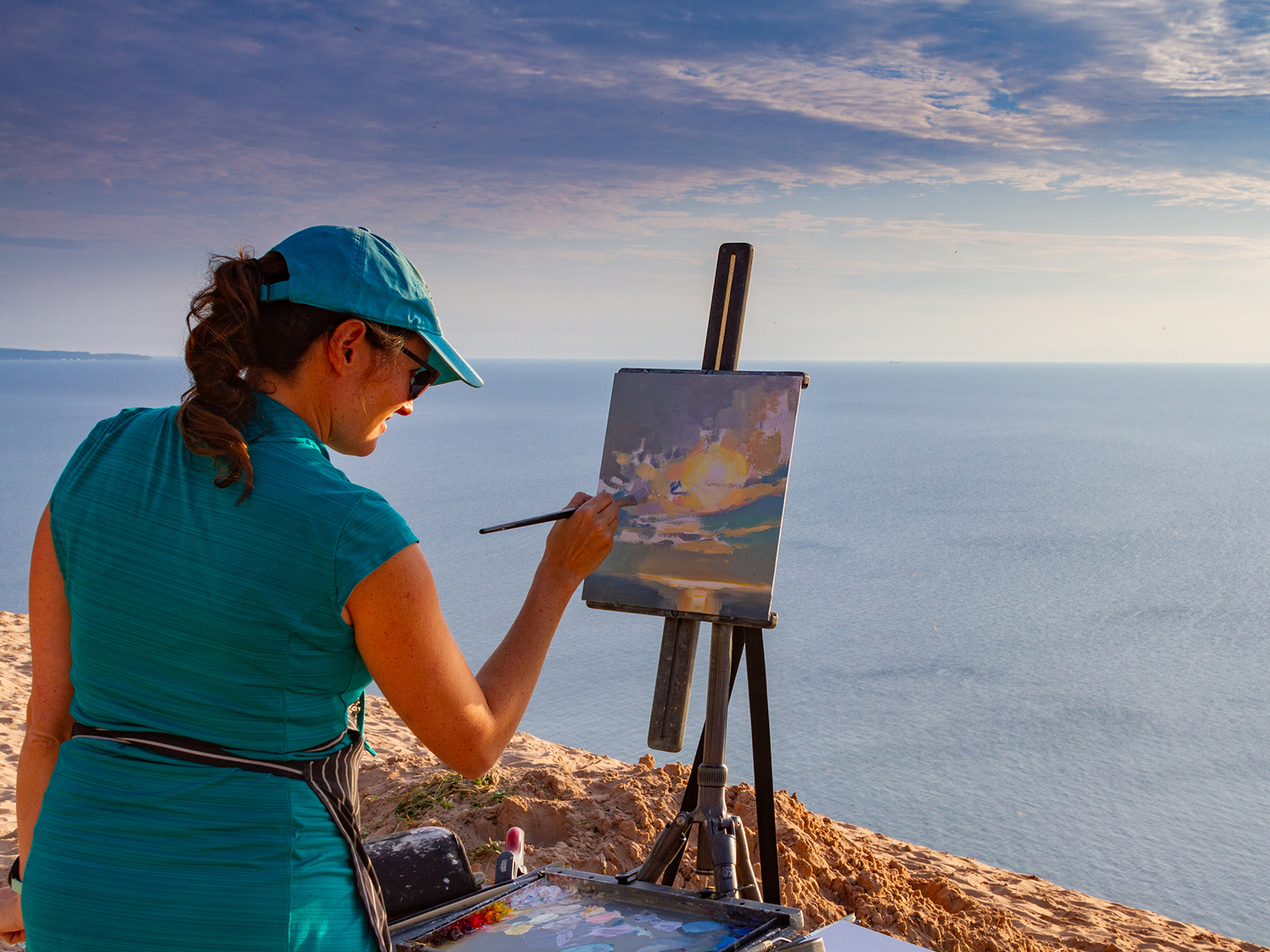 A woman painting in Traverse Bay