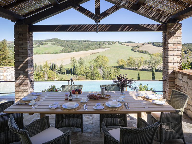 Dining table with a view over Tuscan hills