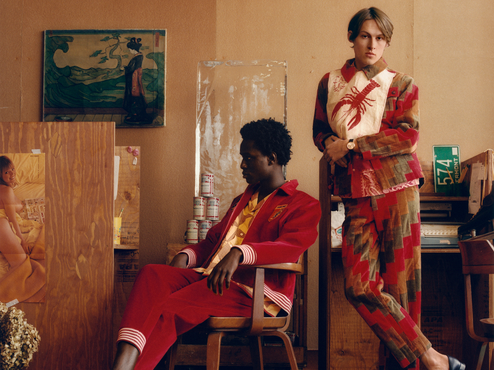 Two men model red quilted suits