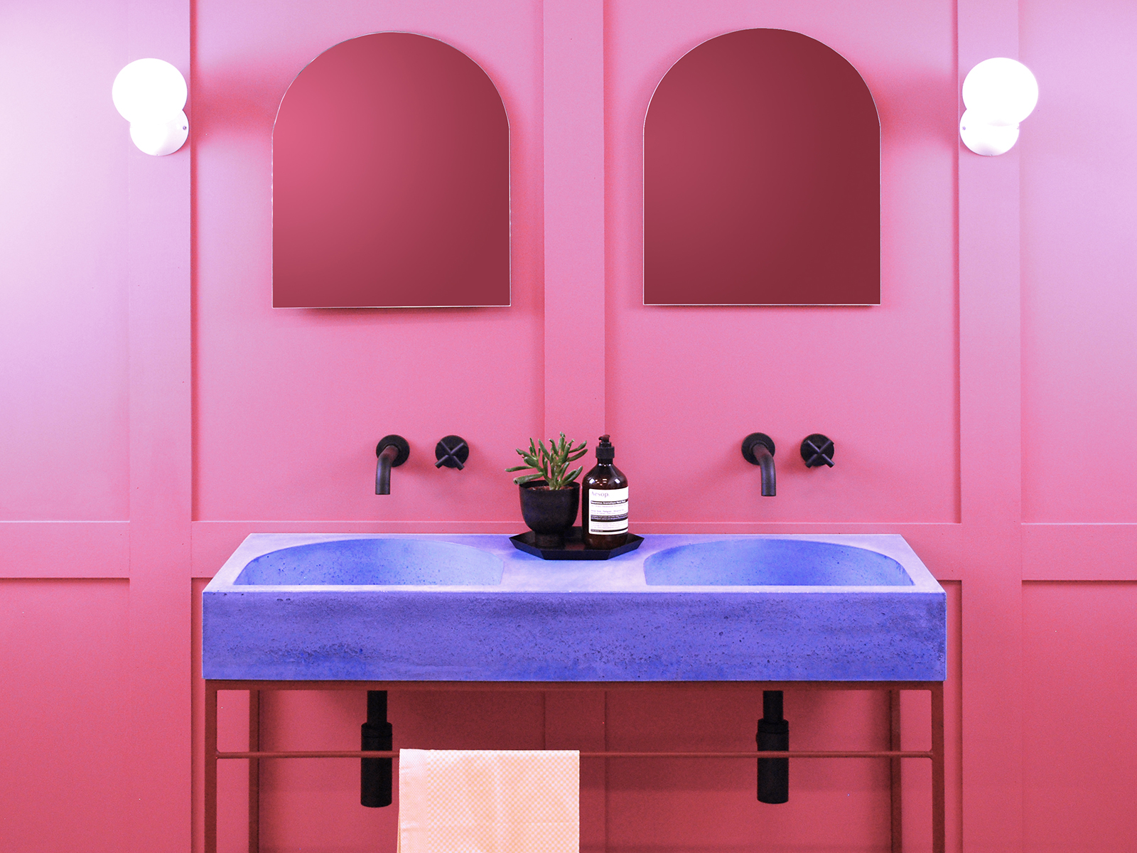 A curved purple concrete basin against a bright pink wall