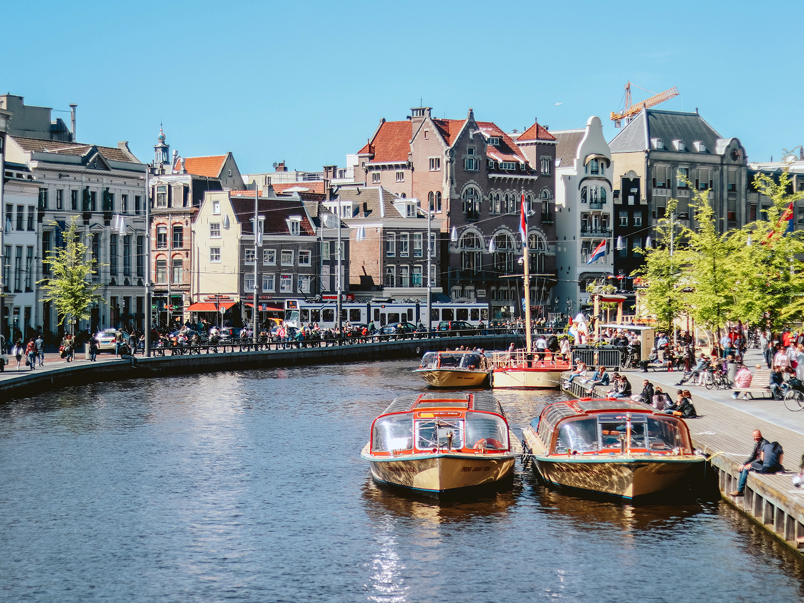 Canal boats in front of Amsterdam's famous merchant houses