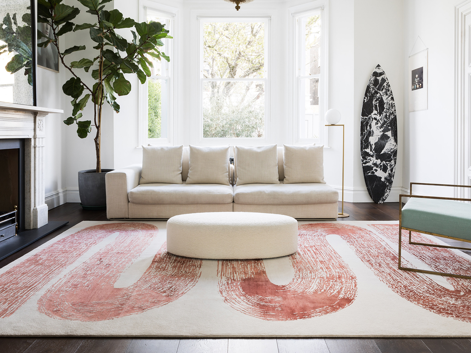 A white and terracotta rug in a living room
