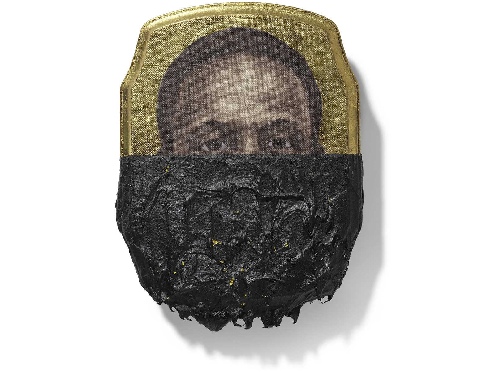 A portrait of an African American man's face with the lower half obscured by tar