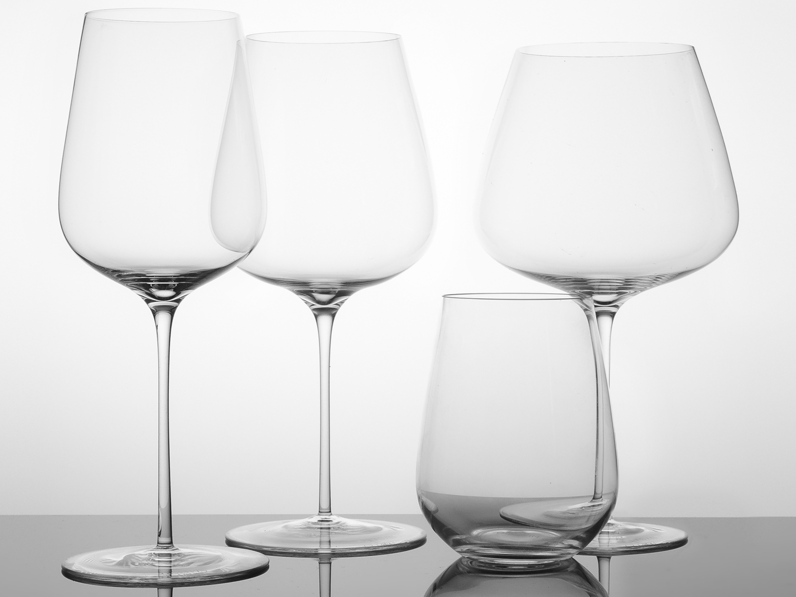 Four wine glasses in the Glasvin range by David Kong
