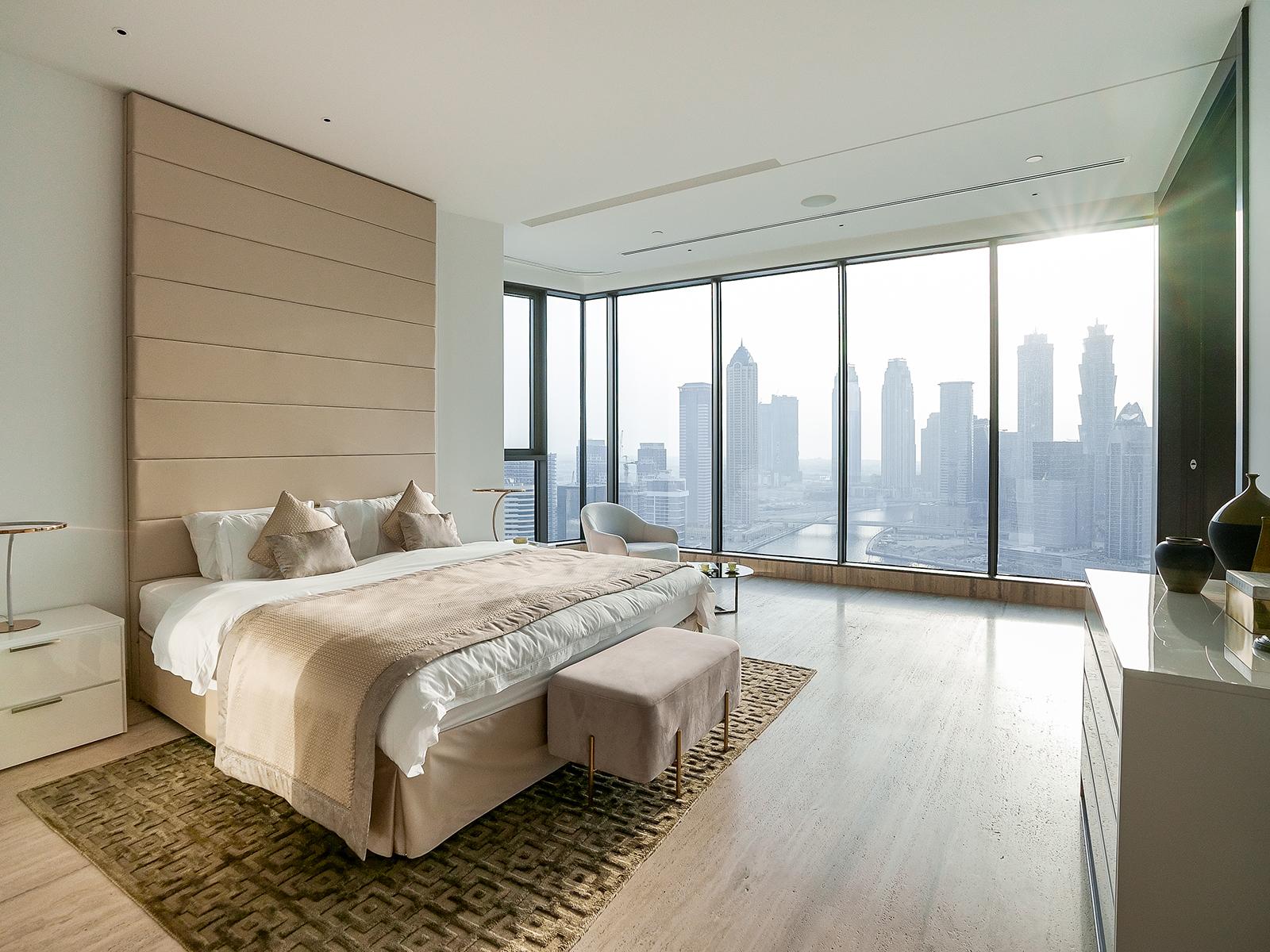 A penthouse bedroom with views of the Dubai skyline