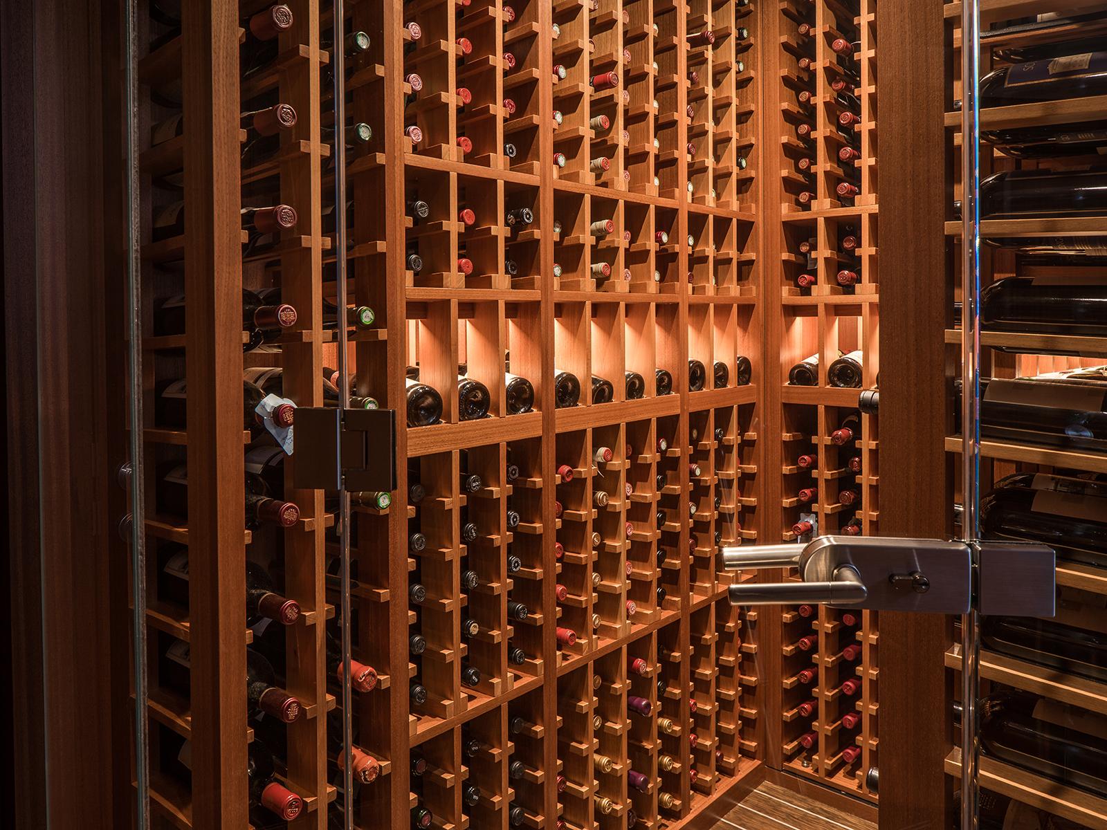 Dark wood wine storage onboard a yacht