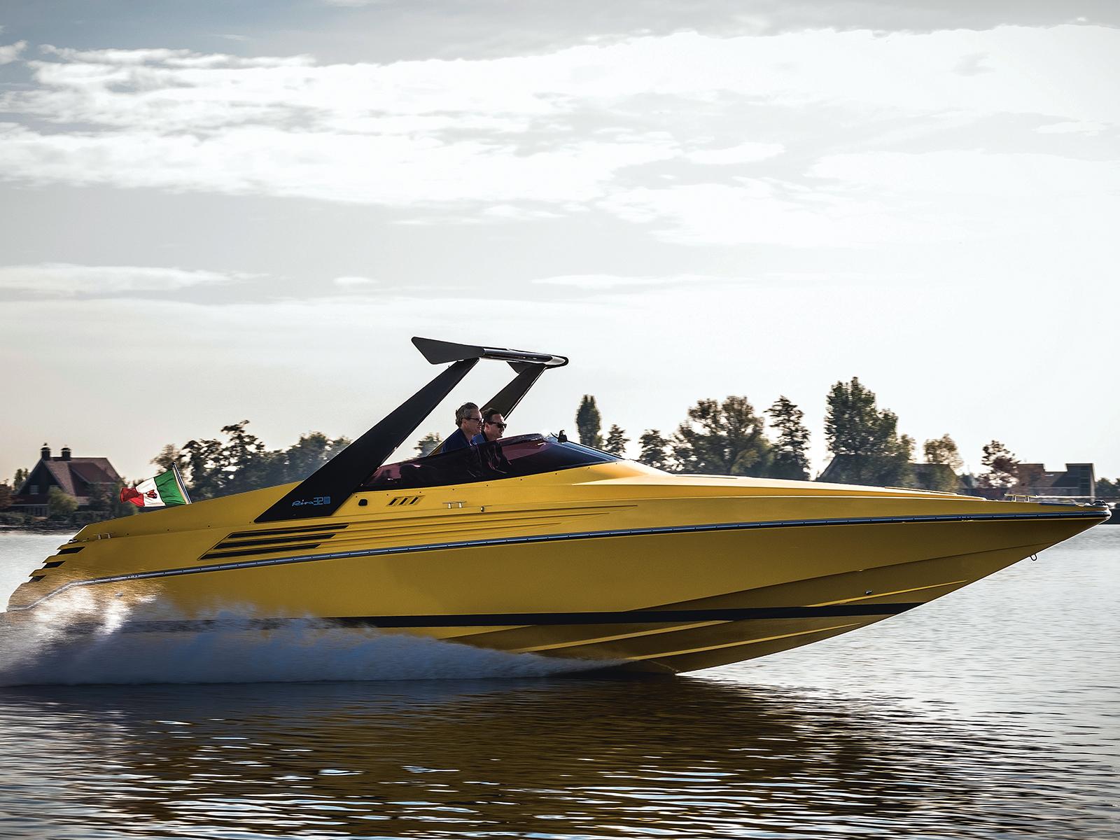 A yellow Riva Ferrari 32 on the water