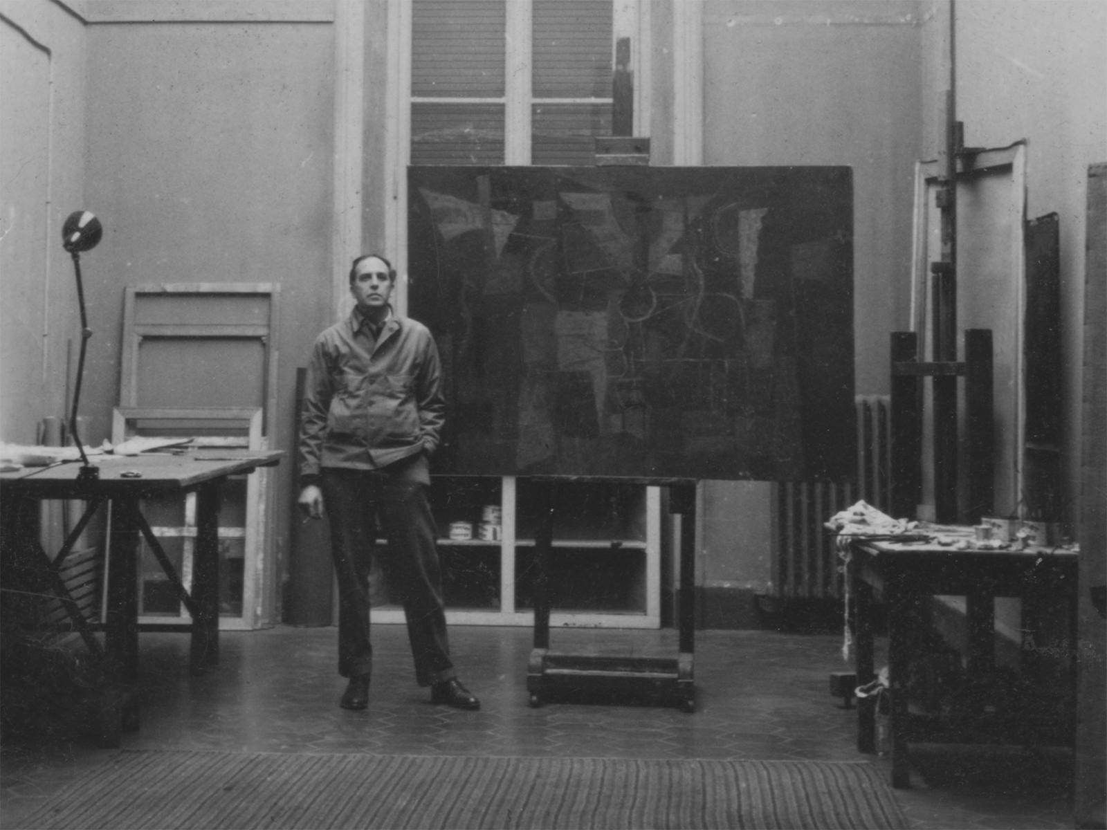 Black and white picture of Philip Guston in his studio