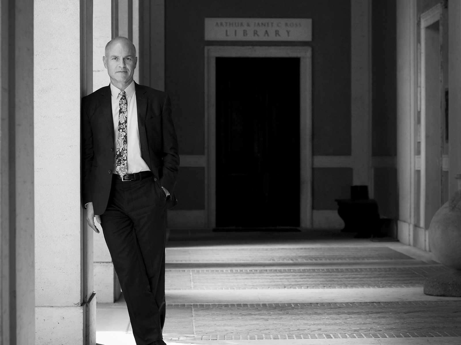 A black and white full length portrait of American Academy in Rome CEO Mark Robbins