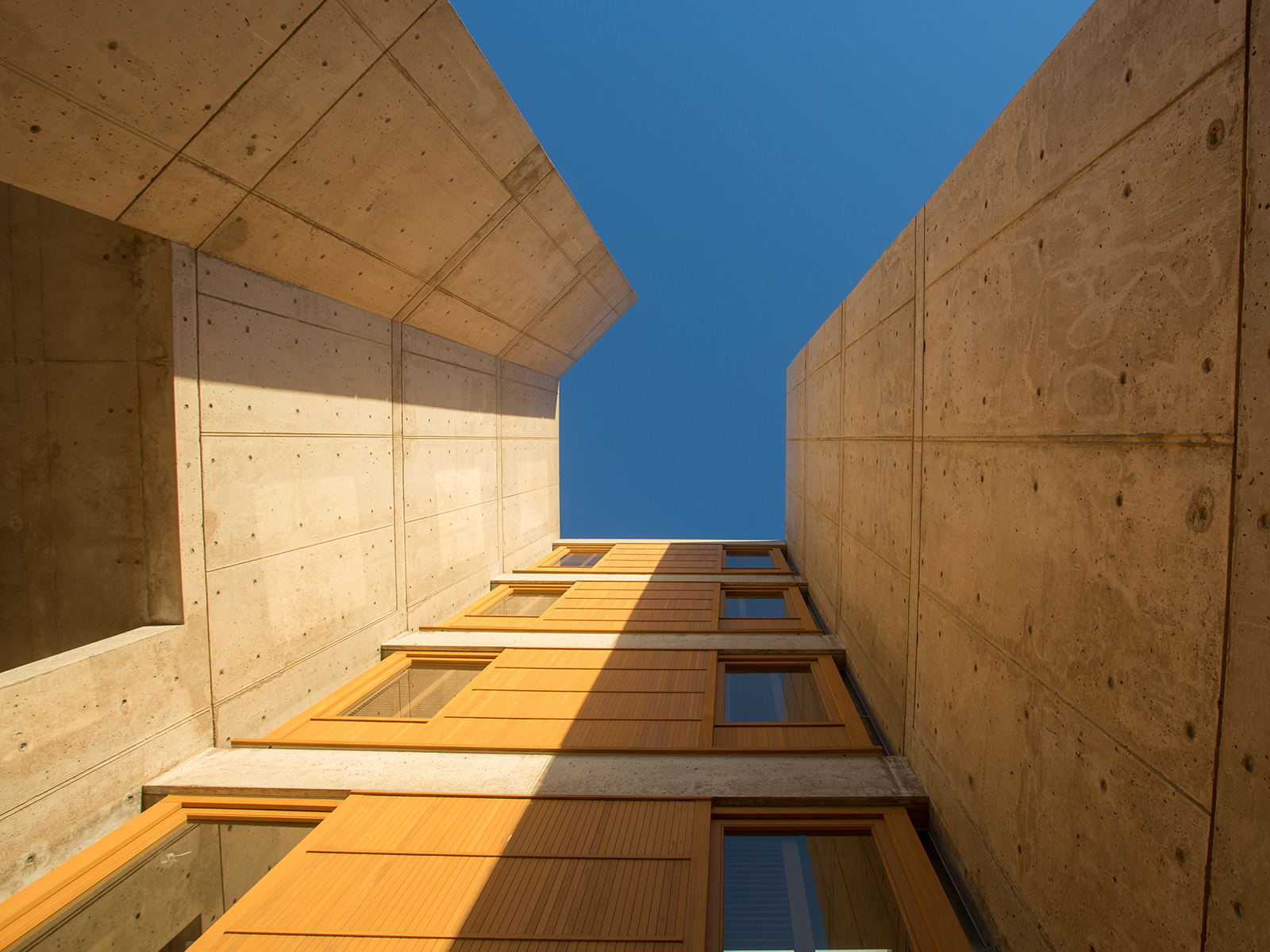 A view from the ground up the side of a building at the Salk institute