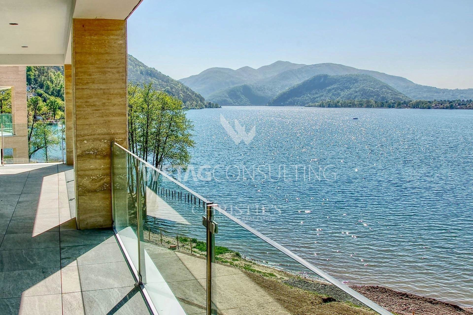 Residence/Apartment for Sale at Prestigious 2-bedroom apartments for sale in Muzzano directly on Lake Lugano Muzzano, Ticino,6933 Switzerland