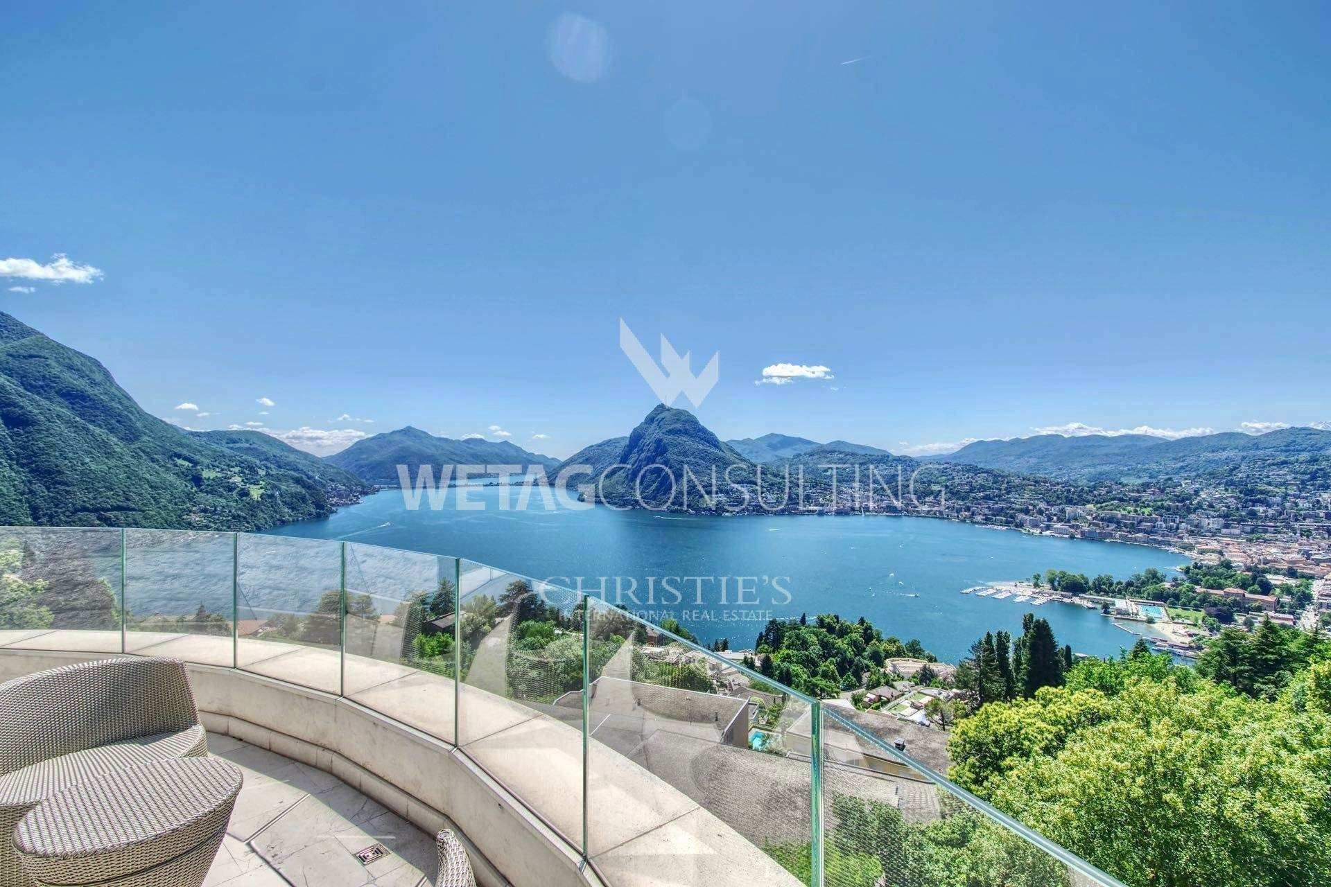 Апартаменты / Квартиры для того Продажа на Luxury duplex-penthouse in Aldesago with wonderful Lake Lugano view Aldesago, Тичино,6974 Швейцария