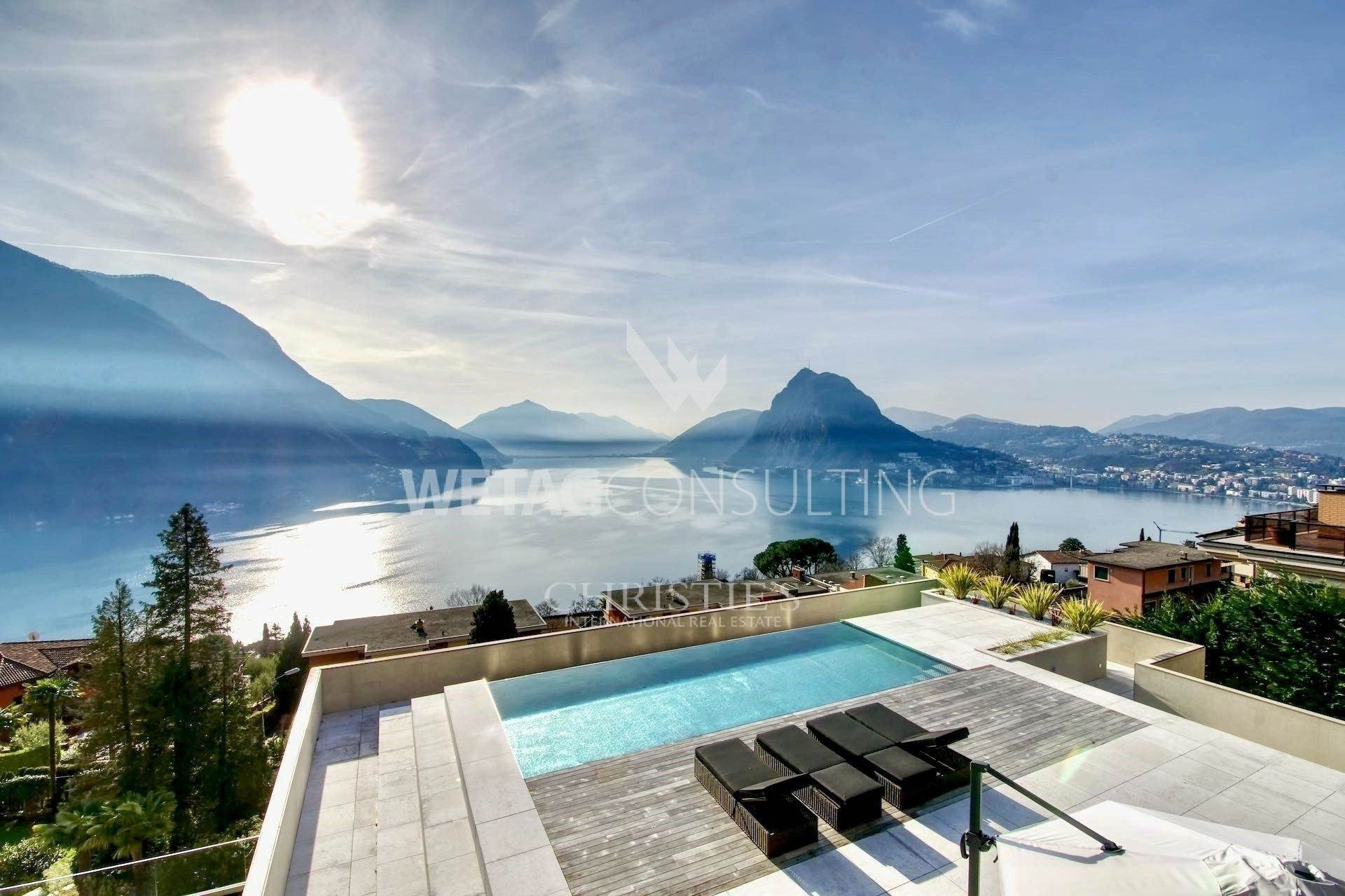 Apartamento por un Venta en Modern & luxury duplex-penthouse with pools & large terrace in Ruvigliana for sale Ruvigliana, Tesino,6977 Suiza