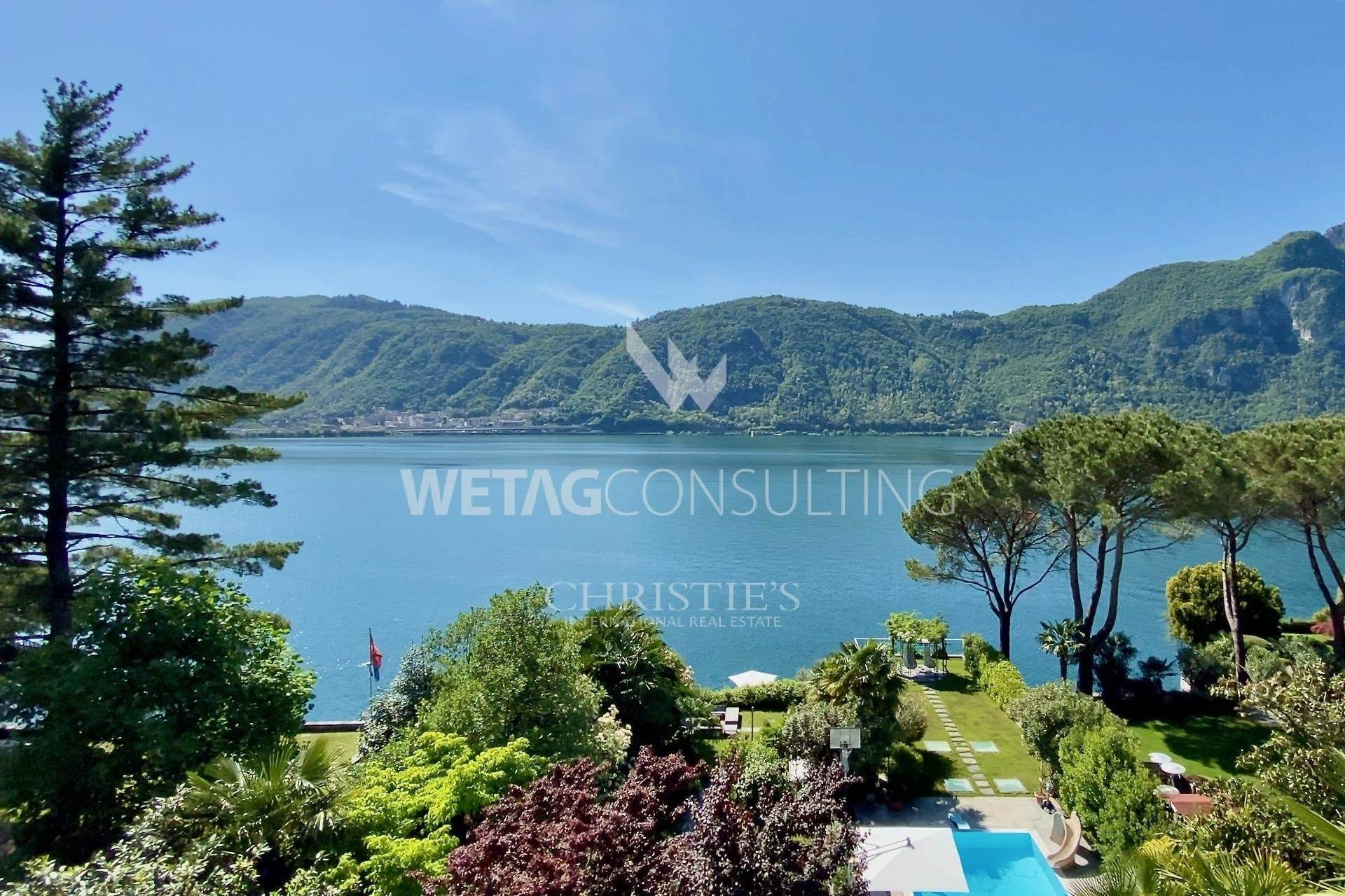 Villa/Townhouse for Sale at Gorgeous lakefront villa with boathouse in Bissone for sale Bissone, Ticino,6816 Switzerland
