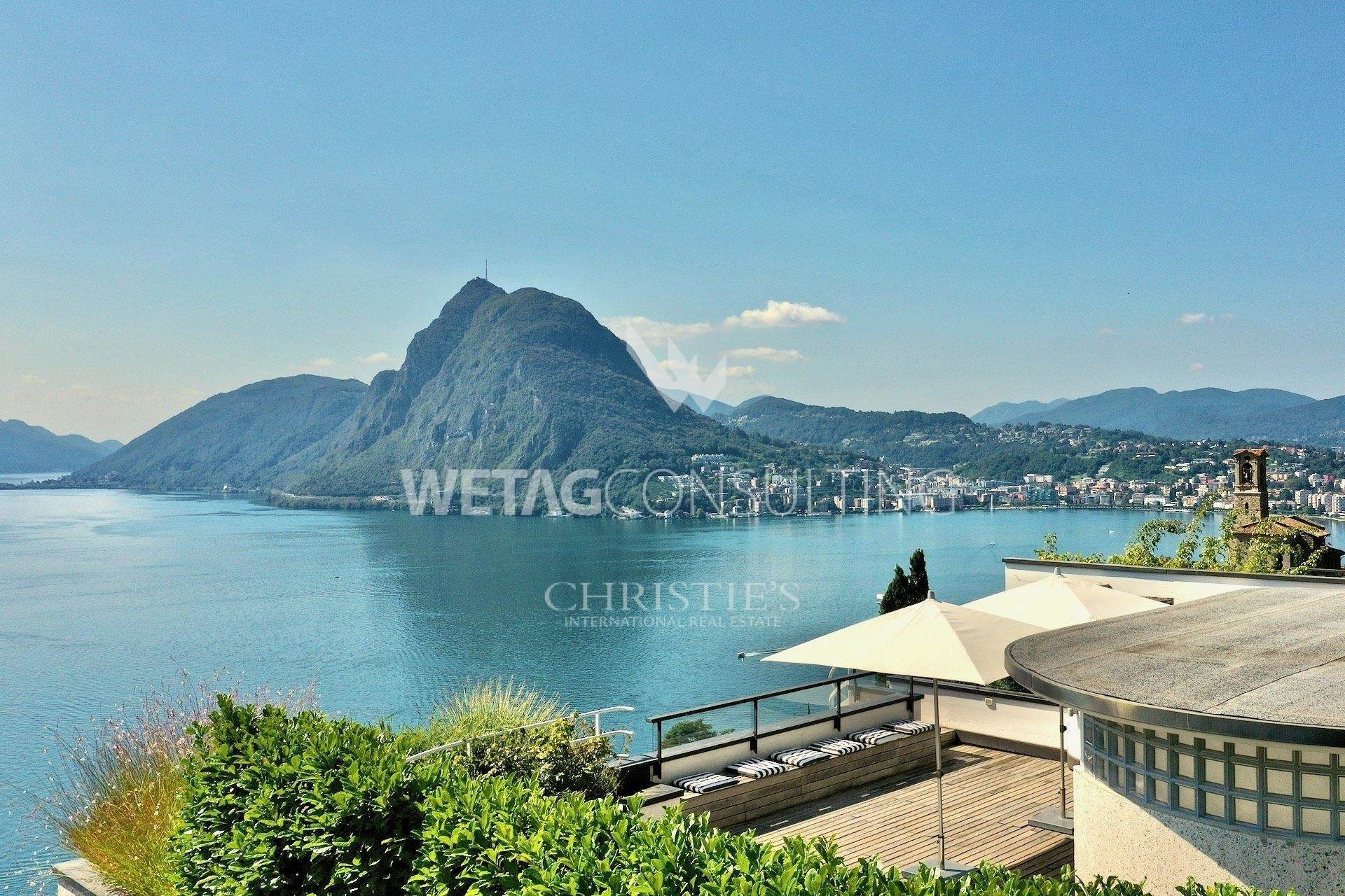 Apartamento por un Venta en Lake view & large rooftop terrace: penthouse apartment in Ruvigliana for sale Ruvigliana, Tesino,6977 Suiza